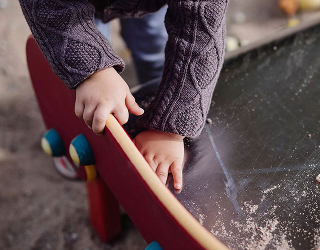 Child wiping a chalk board.